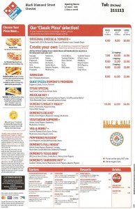 Dominos pizza menu: An Example of the traditional  Dominos pizza menu. CLICK on in twice to enlarge it. Please note that the menu is an example only and prices and pizza items may have changed. See Dominos.com for more info.